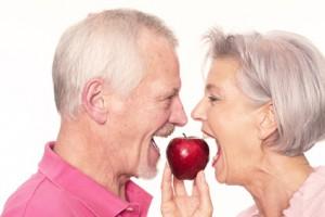 Senior couple with apple